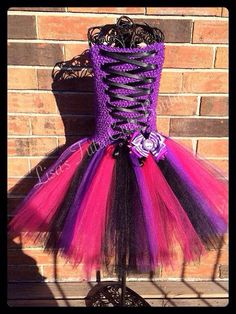 Please read all before purchase.    This Monster High themed dress is a must have for your Monster High fan! Dress comes on a stretchable purple