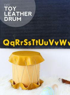 This toy leather drum is a really easy and cute craft to make as a gift for a young child. Mini versions would also be cute as favors for a child's music party. You could experiment with drum sticks too. I was thinking felted pom poms attached to chopsticks? Could be a cute addition!
