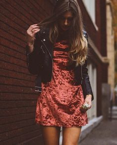 burnt orange crushed velvet dress with leather jacket