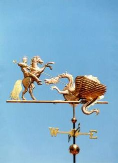 Saint George and the Dragon Weathervane by West Coast Weather Vanes.  This design, in particular, benefits from optional gold leafing. It is particularly beautiful when we gilded St. George's halo, his face and hands, the horse's mane and tail and the spear itself.