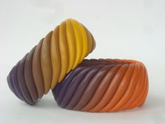 2 bangles using snakes of blended colours by Carol Blackburn.  Polymer clay.