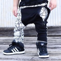 * Soft and comfortable drop crotch zipper joggers made of black and light heather gray * Black zipper pocket in the front * Black vertical pocket on the back (Right side) * Size is comparable to our r