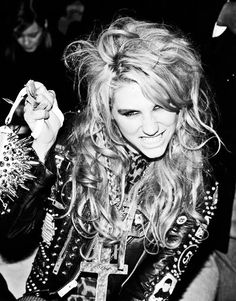 She looks like she has dirt on her face at all times, but I freakin' loveeeeee her music. It's so catchy.