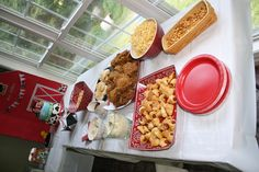 The barnyard party food table.  fried chicken, sides, pigs in a blanket, hay (potato straws) corn nuts...