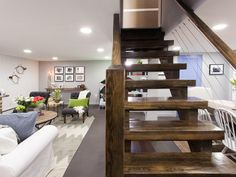 AFTER: Staircase - Basement Remodeling Ideas From TV on HGTV. I like the idea of opening up the stairs.