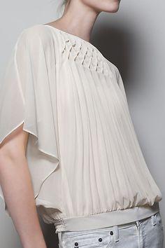Gotta love a good vintage-inspired silk blouse.