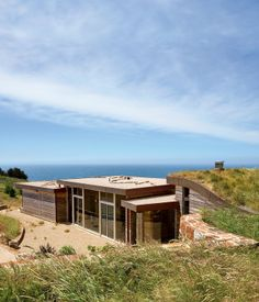 Architect Mary Ann Schicketanz created a 1,900-square-foot home in Big Sur, California, that hugs its hillside site. Read more about this...