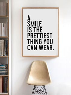 A smile is the prettiest thing you can wear - beautiful clean graphic inside a thin golden picture frame | clean modern room ispiration