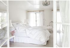 Even though she lives in a warm climate, Ashwell wanted her home to still feel cozy and romantic. Which is why there are multiple fireplaces and (most importantly) a heavenly all-white master bedroom.