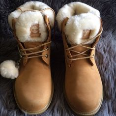 Fur Timberland boots Kids 3 (converts to women's 5) These are wheat timberland boots with a cream fur. Comfortable, cute and rarely worn. Three small marks as shown in second pictute but may be removable. Timb are back and style, cop them now and wear them year round. Timberland Shoes Winter & Rain Boots