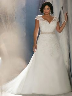 Cap sleeves, a scalloped neckline, fitted bodice and a crystal beaded waistband create an elegant look for any bride. This Julietta by Mori Lee plus size wedding gown will accent your full figure in all the right places!