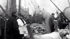 Burying some of the Titanic dead at sea.