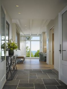 Open Entry Hall with Lake View Hallway Foyer Outdoor Room Transitional by Robbins Architecture