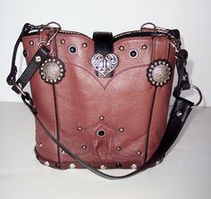 This StageCoach Bag is made from a Justin cowboy boot.  Named Dusty Rose because of her color!  Beautiful inside as well as outside.  A perfect size for carrying all of your personal items out for an evening concert.  www.stagecoachbagsandcollectibles.com Dusty Rose, Cowboy Boots, Bucket Bag, Purses, Personalized Items, Concert, Leather, Bags, Color