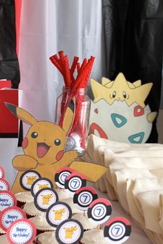 Craft, Interrupted: Pokemon Party: Table Decorations (with Printables! Birthday Party Tables, 6th Birthday Parties, Birthday Ideas, Pokemon Themed Party, Pokemon Birthday, Pokemon Party Decorations, Table Decorations, Centerpieces, Festa Pokemon Go
