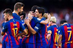 Luis Suarez of FC Barcelona celebrates with teammates after scoring his team's…