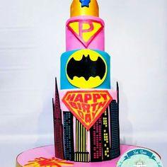 wonderwoman , batgirl, supergirl themed cake