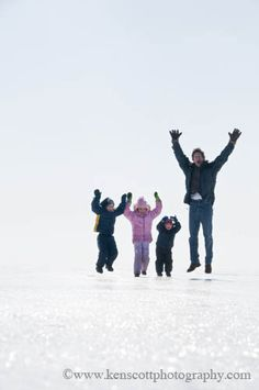Cheering for joy family photo in winter