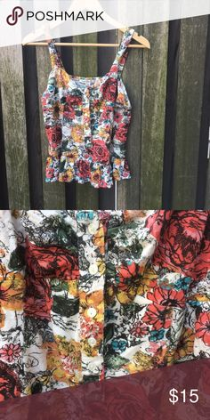 American Rag Floral Tank American Rag Floral Tank   Multi-Colored Floral Pattern over White   Button in front extend halfway to hem   Super cute summer Tank   Never worn   Size Medium American Rag Tops Tank Tops