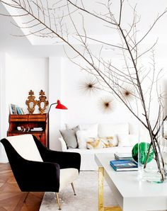 Eclectic #living room with branches
