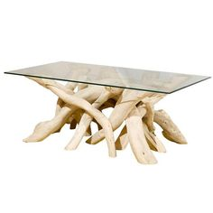 soft bleached driftwood table base with rectangular glass top