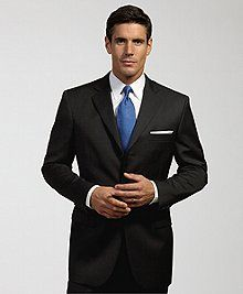 Fitted navy pinstripe suit with brown shoes dressing up Blue suit shirt tie combinations