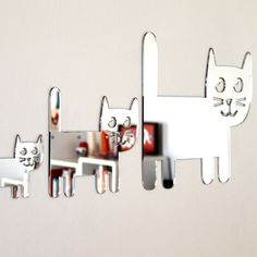 Shatterproof Cat Family Mirrors from Scoop Design, all Australian made (have loads of other animals).  Also make jewellery, limited edition prints, cards, quirky bits and bobs with bright coloured characters