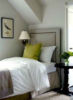 Great inspiration for guest bedroom. striped headboard, inlay with nailhead and green accents.