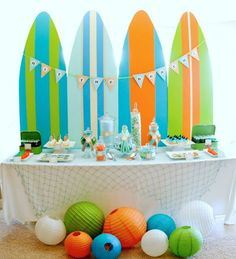 Surfs up with this bright and fun beach birthday party! Ride the waves with creative banners, {sand}wiches and beach balls!