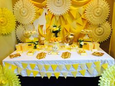 Yellow backdrop at a giraffe baby shower party! See more party planning ideas at CatchMyParty.com!