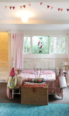 love this little girls room. I have been trying to find the perfect color of rug for my daughters room, and the color of the rug at the bottom of the bed may be my answer. huzzah!