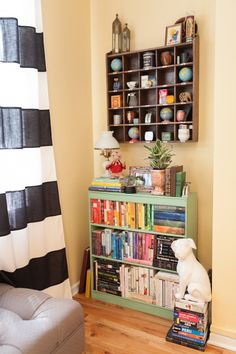Elizabeth's Color-Filled Apartment (Note: Love the little compartments)