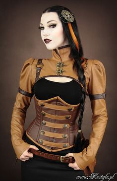 Steampunk bolero  Made of faux leather in color of caramel.  Decorated with dark brown straps with O-rings and rivets