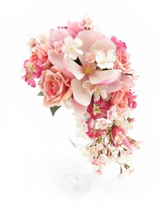 Trail bouquet of cherry blossom, pink roses, stock florets and magnolias. Find your perfect wedding flowers at www.loveflowers.com.au