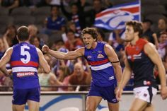 Minson celebrates goal against Demons - The Western Bulldogs' Will Minson celebrates a goal during the round 23 AFL match against the Melbourne Demons at Docklands on September 1, 2013 in Melbourne.