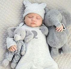 Sweetly sleepy baby snuggeling her friends