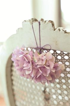 pink hydrangea hung on a vintage chair via French Larkspur {Jeanne d' Arc}