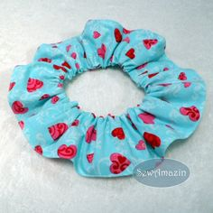 Your dog or cat will look sweet as candy in this Valentine's Day scrunchie neck ruffle. The cotton fabric is suitable for boys or girls and features lovely patterned hearts in hues of red and dark pink on a cotton candy blue and white damask background. | SewAmazin @sewamazin #indiemade #valentine #heart #pets