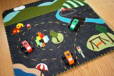 Love this...a little early? Maybe... wool felt playmat  little city big country by playdaytoys on Etsy, $60.00