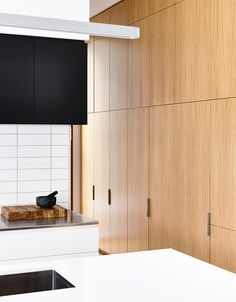 Love this kitchen. Timber, black and white in great proportions.