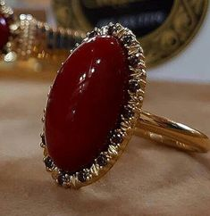 @gusibat_jewellery. Blood red Coral Ring #redrubyrings Gold Rings Jewelry, Gold Jewelry Simple, Stylish Jewelry, Bridal Jewelry, Diamond Jewelry, Jewelry Accessories, Gold Ring Designs, Gold Earrings Designs, Gold Jewellery Design
