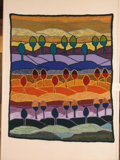 This is a rug hooked by Ellen Jawarski.  Wouldn't it make a beautiful quilt?