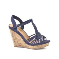 Step out in style and add some height   to your spring/summer outfit with these sky high cork wedges in a   classic navy shade, perfect with denim hotpants and a rope twist vest   for poolside glamour! Woven strap detailBuckle fastening