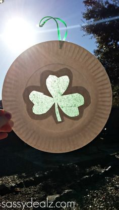 Shamrock Suncatchers are easy St. Patrick's Day crafts for kids to make to decorate for the holiday! I would have never thought to do this with paper plates.
