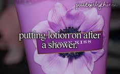 Putting lotion on after a shower.