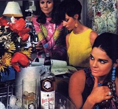 Just ran across this - an advertisement photo probably for the brand of booze sitting there. It's Allie McGraw when she was still modeling and not 'turned' actress yet - she started movies in '67-68 ish so this is looking sort of mod 1966ish clothing & earrings to me.