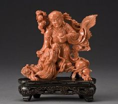 Chinese carved red coral sculpture depicting 1