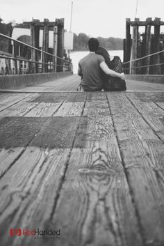 couple photography in black and white ; dock ; wharf