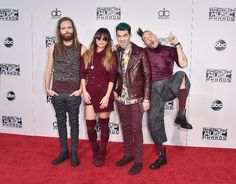 Jack Lawless, from left, JinJoo Lee, Joe Jonas, and Cole Whittle of DNCE arrive at the American Music Awards at the Microsoft Theater on Sunday, Nov. 22, 2015, in Los Angeles.