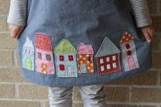 close up of the applique houses. Some windows I used wool felt; others I made with a satin stitch.